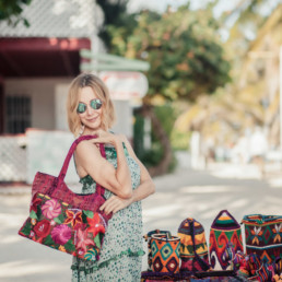 Lisa Breckenridge with purse in Belize