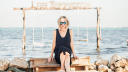 Lisa Breckenridge with sunglasses on beach in belize