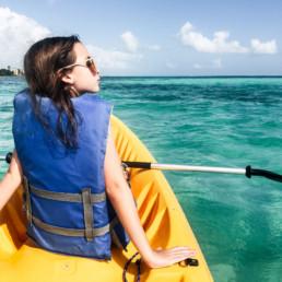 Lisa Breckenridge kayaking with family in Belize