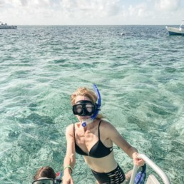 Lisa Breckenridge swimming with family in Belize