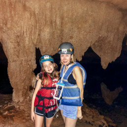 Lisa Breckenridge exploring caves with family in Belize
